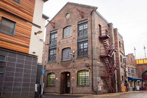 Building, Town, Neighbourhood, Architecture, Property, Urban area, House, Brick, Street, Wall,