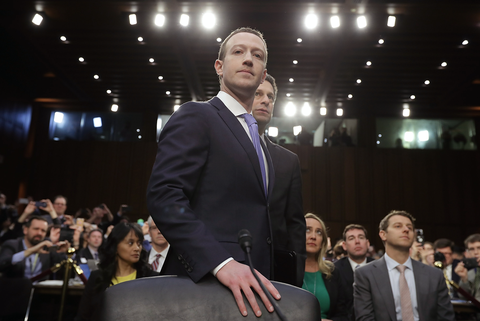 Facebook co-founder, Chairman and CEO Mark Zuckerberg arrives to testify before a combined Senate Judiciary and Commerce committee