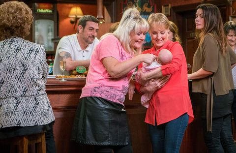 Beth Sutherland and Sally Metcalfe hold the baby in Coronation Street