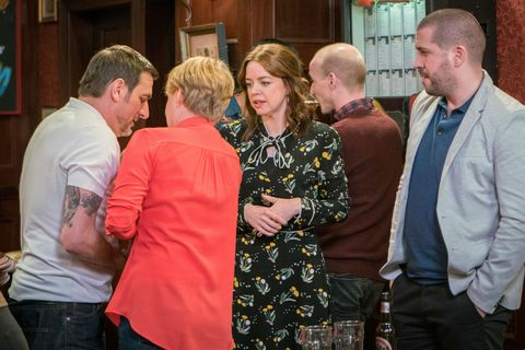 Toyah Battersby shows off the baby in front of Aidan Connor in Coronation Street