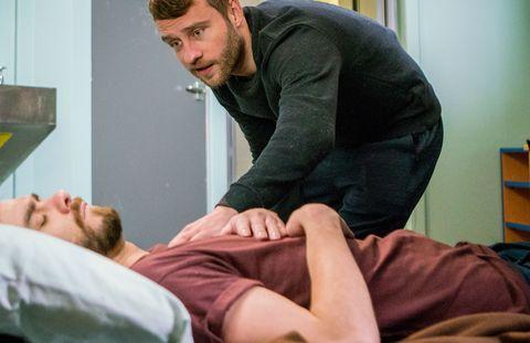 David Platt is startled by his cellmate Paul in Coronation Street