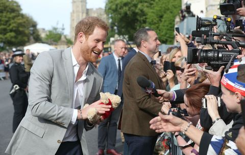 Prince Harry greets members of the public ahead of the royal wedding of Prince Harry and Meghan Markle