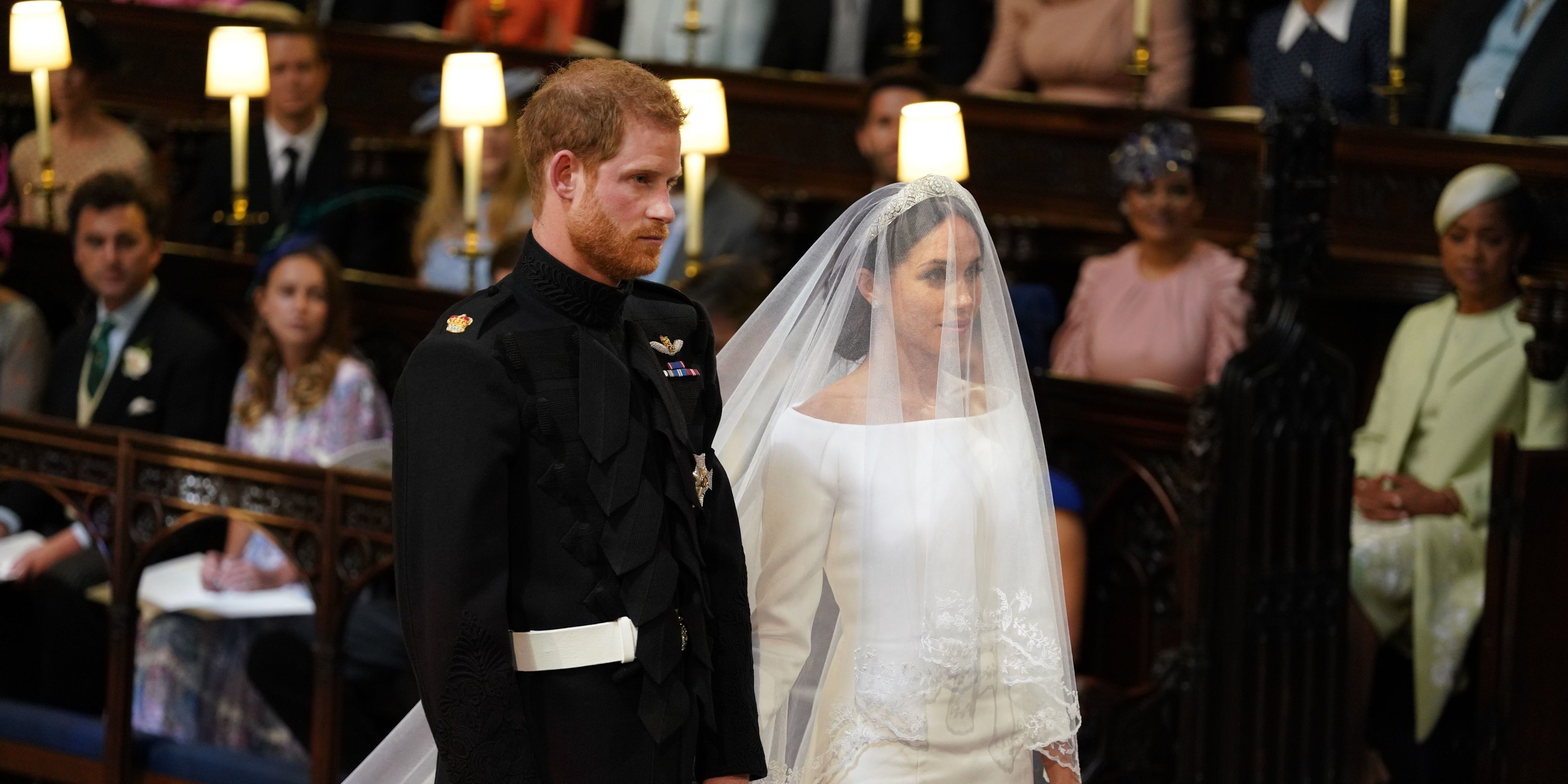 Prince Harry, Duke of Sussex (L) and US fiancee of Britain's Prince Harry Meghan Markle stand together for their wedding