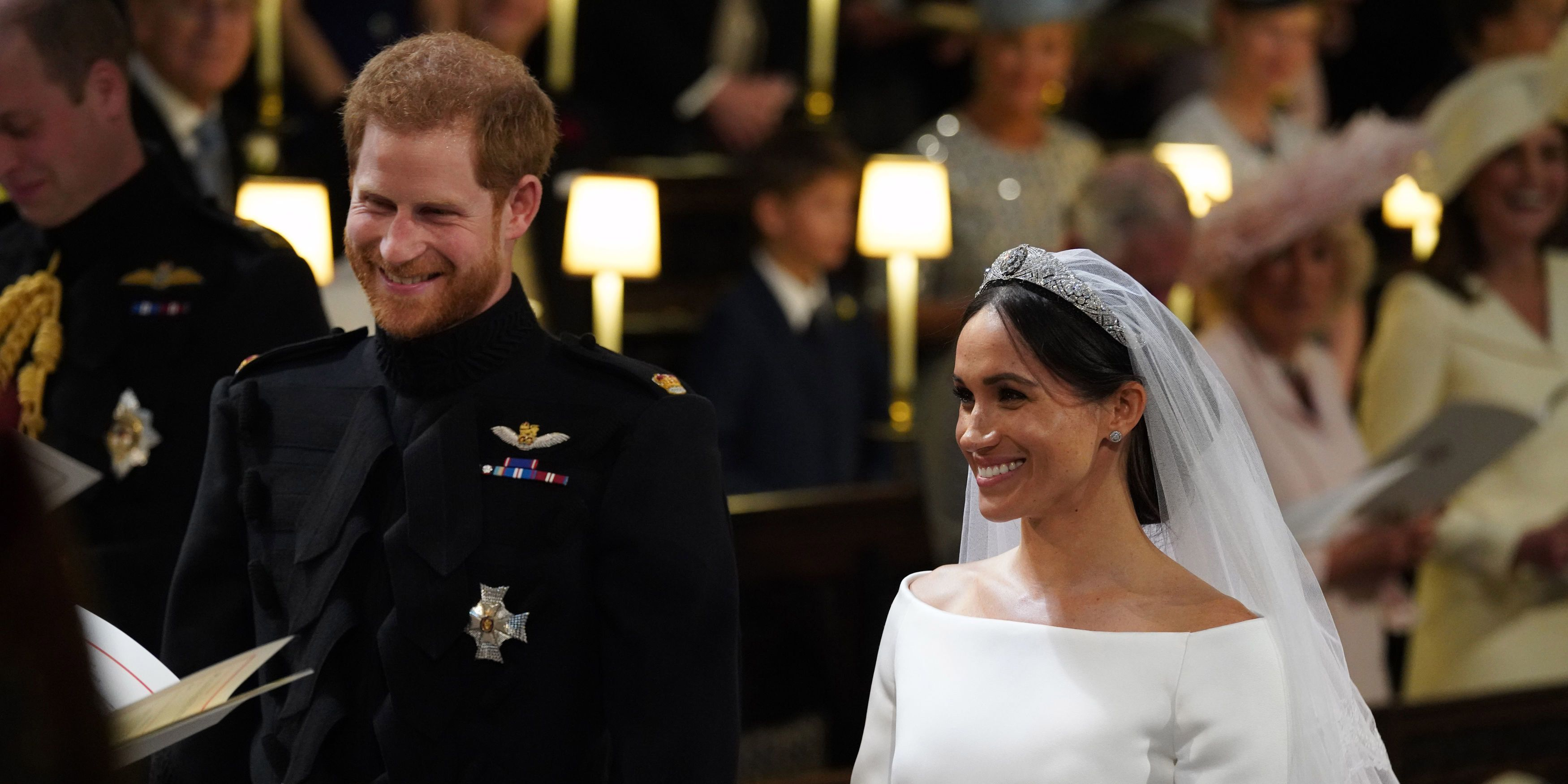 Prince Harry and Meghan Markle stand at the altar during their wedding in St George's Chapel at Windsor Castle