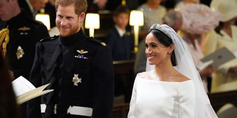 Facial expression, Bridal veil, Formal wear, Veil, Tradition, Bridal clothing, Headpiece, Bride, Ceremony, Wedding dress,