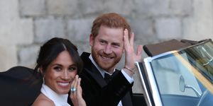 Meghan Markle and Prince Harry wave to the crowds as they head to their wedding reception