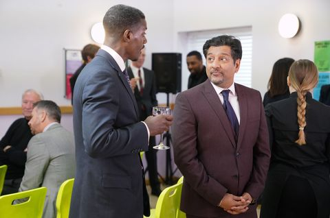 Masood Ahmed mingles with a business crowd in EastEnders