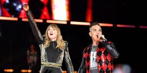 Taylor Swift and Robbie Williams perform on stage at Wembley Stadium on June 23, 2018