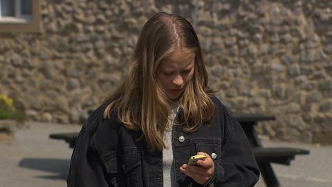 Liv Flaherty on the phone in Emmerdale