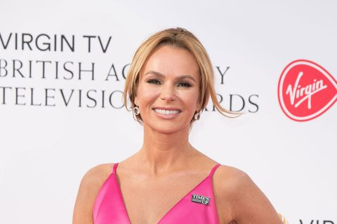 Britain's Got Talent judge Amanda Holden hospitalised after breaking her leg playing on an inflatable assault course