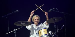 Mary Berry makes a surprise entance on drums and performs with Rick Astley at Camp Bestival