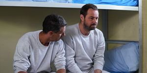 Mick Carter sits with Bob in prison in EastEnders