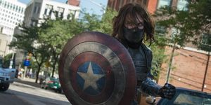 Sebastian Stan with Captain America's shield in The Winter Soldier