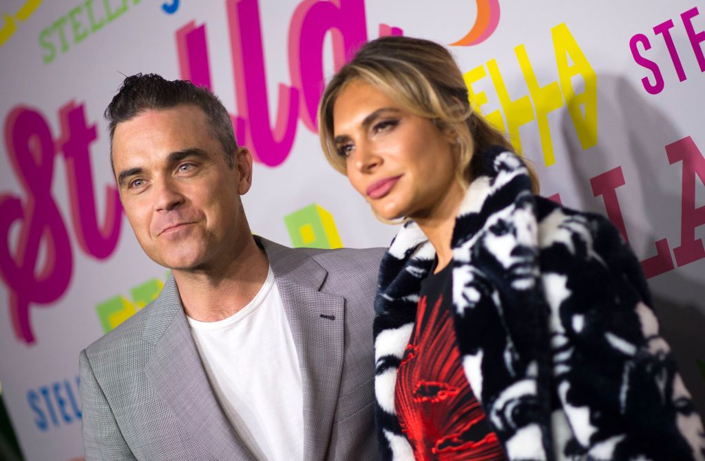 """Robbie Williams hits out at """"feeble"""" Louis Walsh over his X Factor Ayda Field dig"""