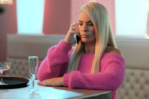 Grace Black makes a phone call in Hollyoaks
