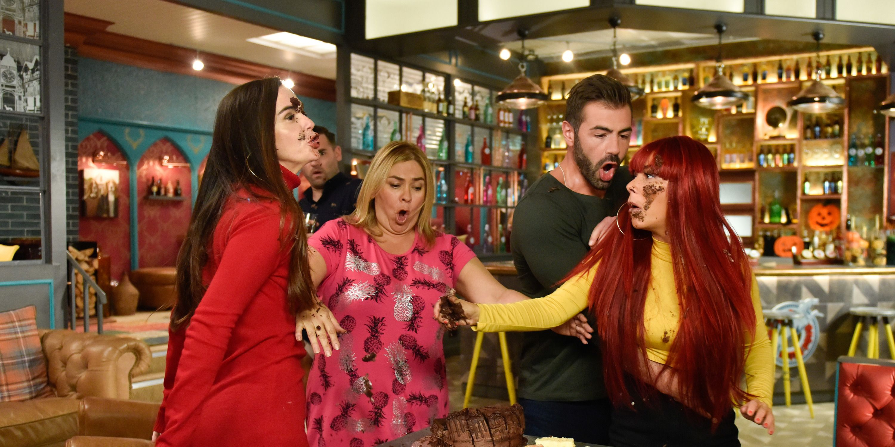 Mercedes McQueen and Goldie McQueen throw cake at each other in Hollyoaks