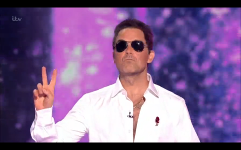 Robbie Williams dressed as Simon Cowell