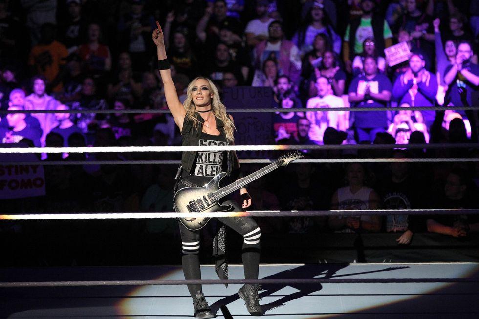 Nita Strauss performing at WWE Evolution