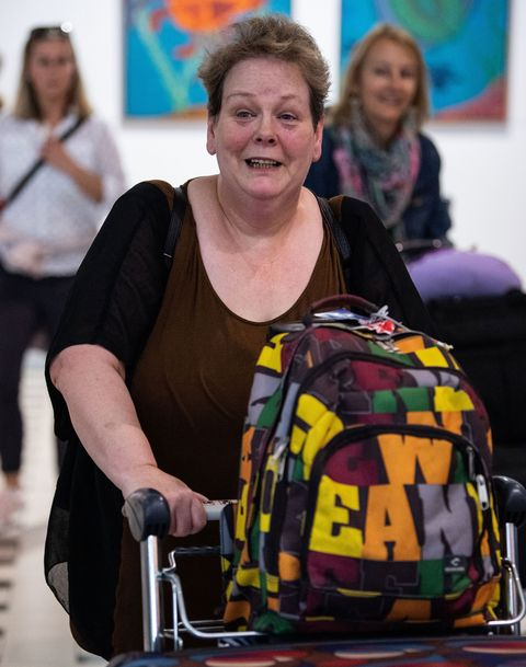 Anne Hegarty arrives at Brisbane airport