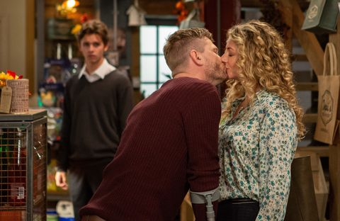 David Metcalfe kisses Maya Stepney as Jacob Gallagher watches in Emmerdale