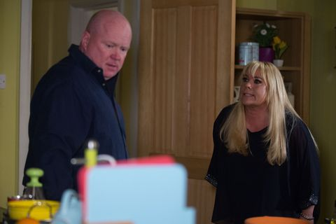 Sharon and Phil Mitchell argue in EastEnders