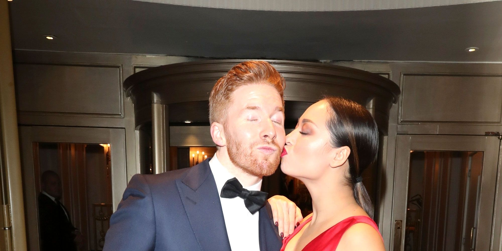 NO REUSE, Katya Jones kisses Neil Jones at Macmillan Cancer Support Winter Gala, London