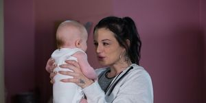Hayley Slater fusses over the baby in EastEnders