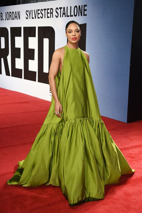 Fashion model, Red carpet, Clothing, Carpet, Green, Dress, Shoulder, Flooring, Fashion, Gown,