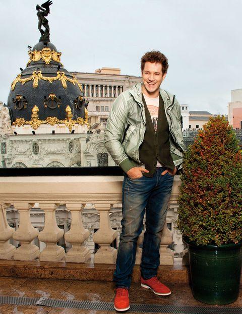 Trousers, Denim, Jeans, Flowerpot, Standing, Outerwear, Jacket, Landmark, Street fashion, Temple,
