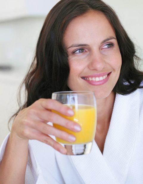 Drink, Juice, Tableware, Beauty, Eyelash, Orange juice, Tooth, Brown hair, Blond, Drinking,
