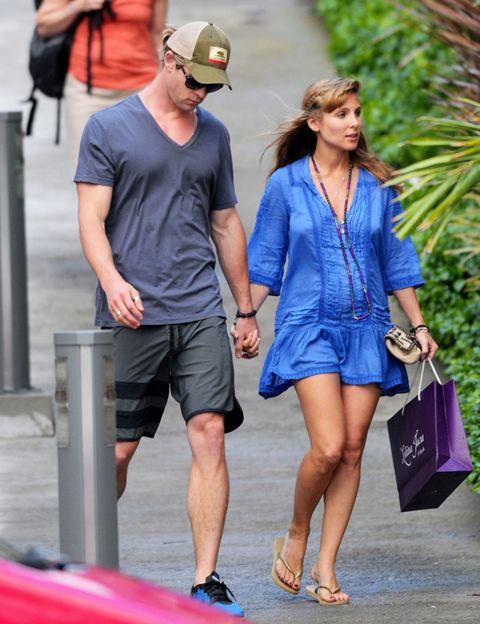 Arm, Leg, Human body, Human leg, Shoulder, Outerwear, Cap, Fashion accessory, Bag, Shorts,