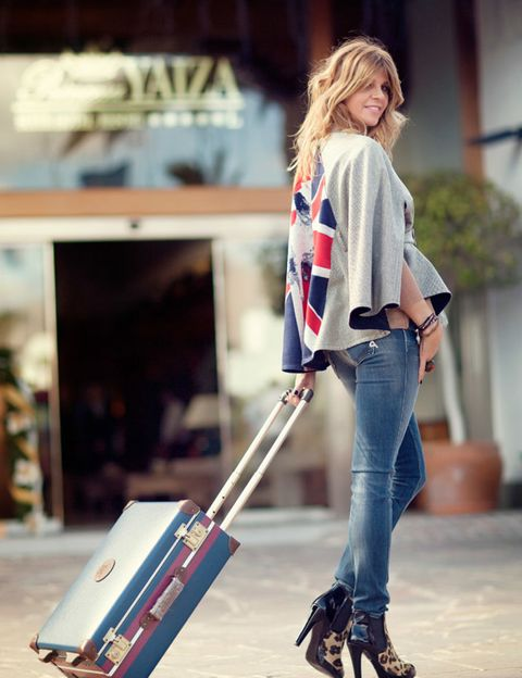 Sleeve, Jeans, Denim, Outerwear, Street fashion, Bag, Luggage and bags, Knee, Electric blue, Baggage,