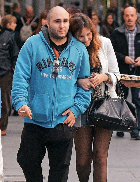 Clothing, Face, Leg, Trousers, Human body, Jacket, Winter, Outerwear, Street fashion, Bag,
