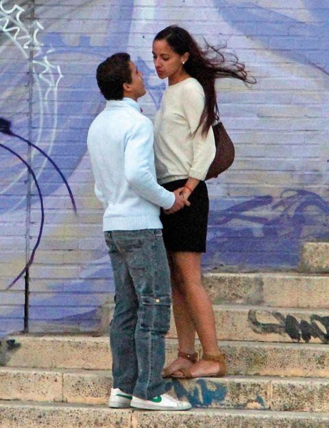 Trousers, Jeans, Shirt, Photograph, Standing, Denim, T-shirt, Interaction, Love, Street fashion,