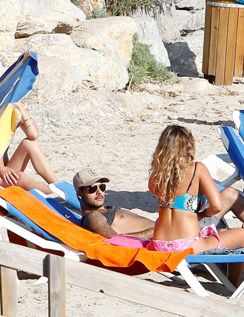 Eyewear, Fun, Brassiere, Swimwear, Swimsuit top, Summer, Leisure, Sun tanning, Bikini, Tourism,