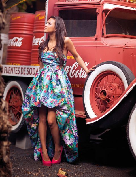 Automotive tire, Human leg, Red, Dress, Fender, Automotive wheel system, Rim, Street fashion, Auto part, One-piece garment,