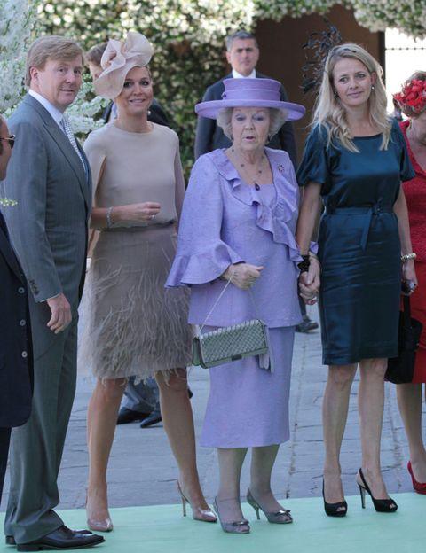 Clothing, Footwear, Leg, Trousers, Dress, Coat, Outerwear, Hat, Formal wear, Style,