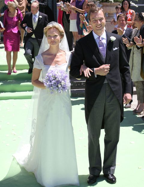 Clothing, Coat, Dress, Event, Trousers, Shirt, Bridal clothing, Photograph, Suit, Outerwear,