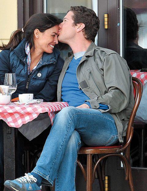 Denim, Sitting, Jeans, Kiss, Interaction, Romance, Love, Conversation, Drink, Street fashion,
