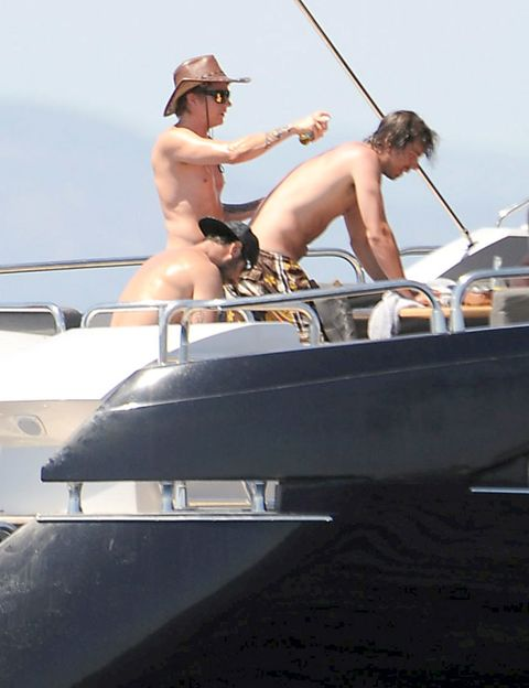 Elbow, Hat, Watercraft, Boat, Summer, Outdoor recreation, Muscle, Vacation, Barechested, Naval architecture,