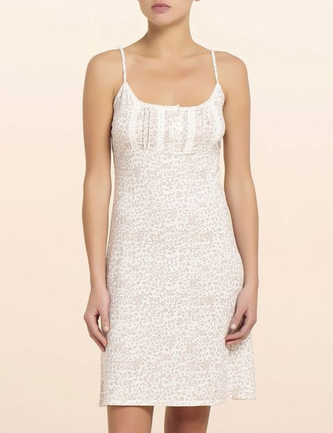 Arm, Sleeve, Shoulder, Standing, Joint, Elbow, White, Dress, One-piece garment, Pattern,