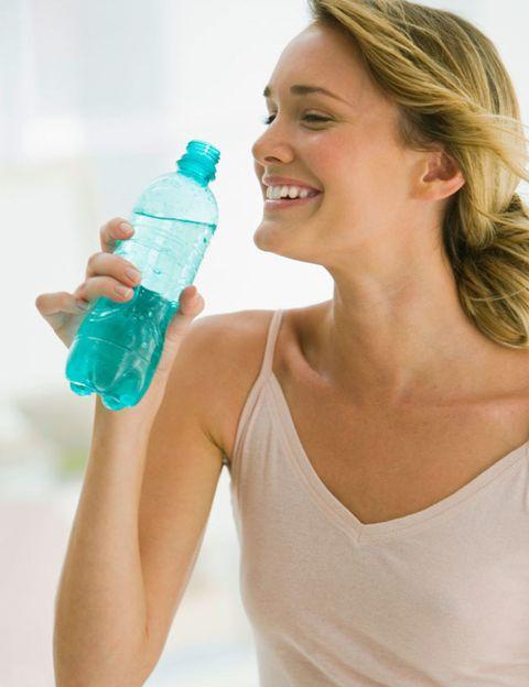 Liquid, Shoulder, Fluid, Bottle, Plastic bottle, Drinkware, Tooth, Neck, Aqua, Sleeveless shirt,