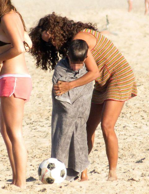 Ball, Leg, Football, Sand, Soccer ball, Human body, Sports equipment, People on beach, Mammal, Brassiere,