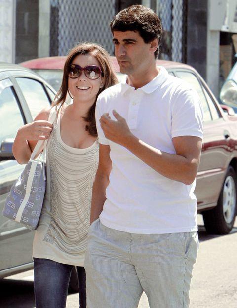 Eyewear, Vision care, Glasses, Trousers, Shoulder, Vehicle door, Standing, Sunglasses, Street fashion, Waist,
