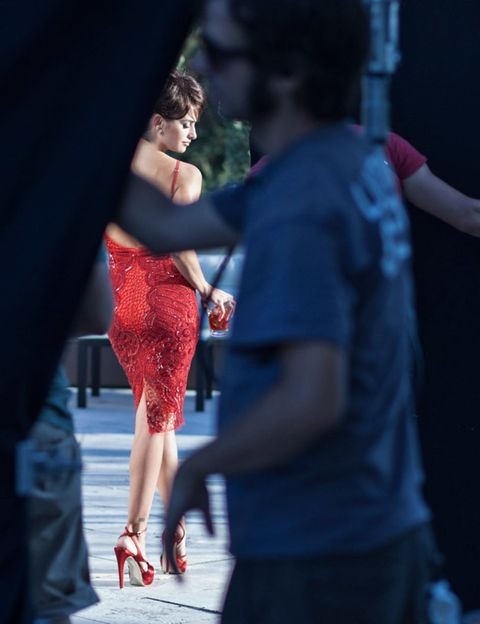 Human leg, Red, Dress, Carmine, Street fashion, Calf, Sandal, One-piece garment, Waist, Sunglasses,