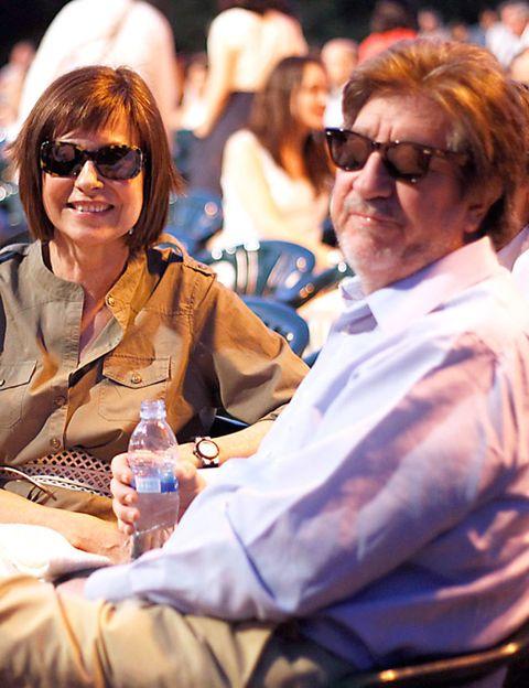 Eyewear, Glasses, Vision care, Water bottle, Bottle, Sunglasses, Sitting, Plastic bottle, Drink, Bottled water,