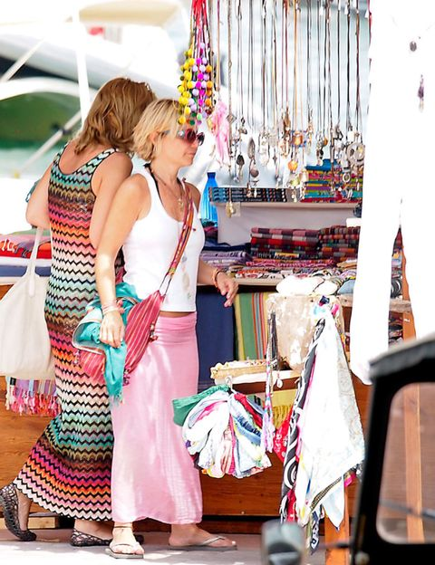 Textile, Party supply, Bag, Party hat, Market, Curtain, Shopping, Sandal, Balloon, Flag,