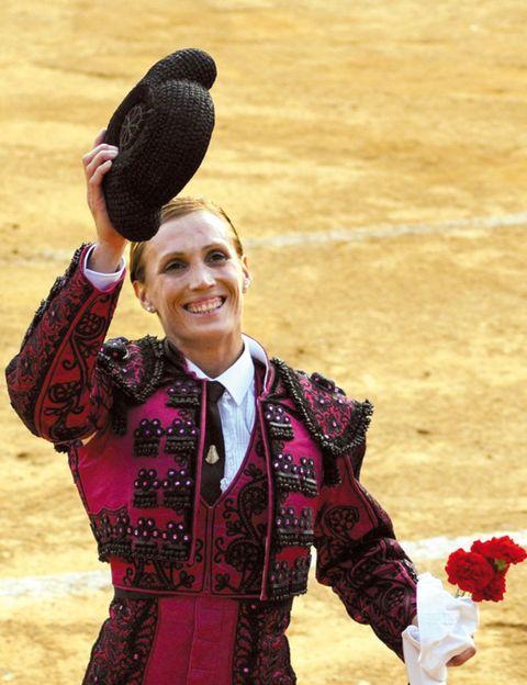 Performing arts, Petal, Bullring, Tradition, Matador, Cut flowers, Dance, Bullfighting, Artificial flower, Flower Arranging,
