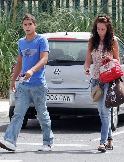 Clothing, Human, Leg, Trousers, Denim, Textile, Jeans, Vehicle registration plate, Car, Style,