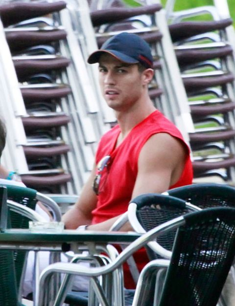 Cap, Product, Sitting, Baseball cap, Muscle, Street fashion, Amusement ride, Ladder, Engineering, Amusement park,